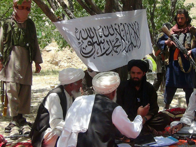 Fighters with Afghanistan's Taliban militia talk with villagers in Ahmad Aba district on the outskirts of Gardez, the capital of Paktia province, on July 18, 2017. Civilian deaths in Afghanistan hit a new high in the first half of 2017 with 1,662 killed and more than 3,500 injured, the United …