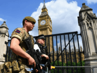 TOPSHOT - A British Army soldier patrols with an armed police officer near the Houses of Parliament in central London on May 24, 2017. Britain deployed soldiers to key sites Wednesday and raised its terror alert to the maximum after the Manchester suicide bombing by Salman Abedi, reportedly a Briton …