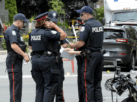 Toronto Police investigate the scene of a shooting the night before in Toronto, Ontario, Canada on July 23, 2018. - Toronto police were seeking to determine a motive on after a 29-year-old man opened fire with a handgun on restaurant goers and pedestrians in a busy neighborhood of Canada's largest …