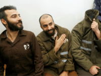 French national Romain Franck (R), 24, a worker at the French consulate, and Palestinian Moufak al-Ajluni (L) and Mohamed Katout (C) appear in court the southern Israeli city of Beer Sheva on March 19, 2018, to face charges of smuggling guns from Gaza. The arrested French citizen and several Palestinian …