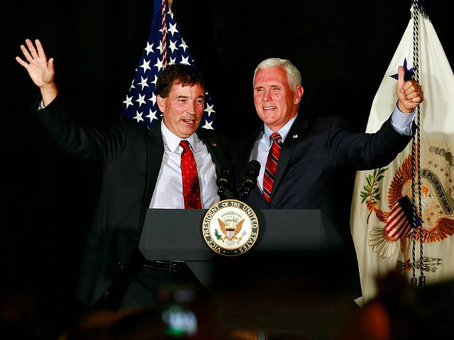 "Vice President Mike Pence, right, waves to the crowd with 12th Congressional District Republican candidate Troy Balderson during a rally at ""The Skylight"" in Newark, Ohio, Monday, July 30, 2018. (Brooke LaValley/The Columbus Dispatch via AP)"