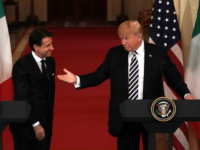 U.S. President Donald Trump (R) and Italian Prime Minister Giuseppe Conte (L) participate in a joint news conference at the East Room of the White House July 30, 2018 in Washington, DC. President Trump held bilateral talks with Prime Minister Conte in the Oval Office earlier. (Photo by Alex Wong/Getty …