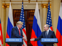US President Donald Trump (L) and Russia's President Vladimir Putin reach out to shake hands before attending a joint press conference after a meeting at the Presidential Palace in Helsinki, on July 16, 2018. - The US and Russian leaders opened an historic summit in Helsinki, with Donald Trump promising …