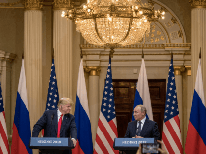 U.S. President Donald Trump (L) and Russian President Vladimir Putin speak to the media during a joint press conference after their summit on July 16, 2018 in Helsinki, Finland. The two leaders met one-on-one and discussed a range of issues including the 2016 U.S Election collusion. (Photo by Chris McGrath/Getty …