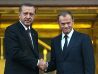 Poland's Prime Minister Donald Tusk, right, and his Turkish counterpart Recep Tayyip Erdogan pose for cameras before their meeting in Ankara, Turkey, Wednesday, Dec. 8, 2010. Tusk is in Turkey for a two-day official visit.(AP Photo/Burhan Ozbilici)