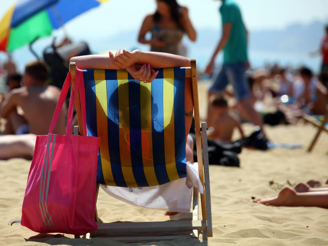 BOURNEMOUTH, UNITED KINGDOM - MAY 25: A sunbathers enjoys the sunshine on the beach on May 25, 2012 in Bournemouth, England. Temperatures in parts of the UK are expected to reach over 27 degrees Celsius today as the spell of sunny weather continues. (Photo by Matt Cardy/Getty Images)