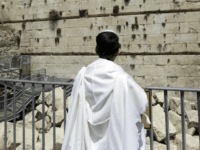 Observing Jew looks at the part f the Western Wall where one of the stones dislodged and crashed into the prayer area in Jerusalem Monday, July 23, 2018. The Western Wall, a retaining wall of the compound where the biblical Jewish temples once stood, is the holiest site where Jews …