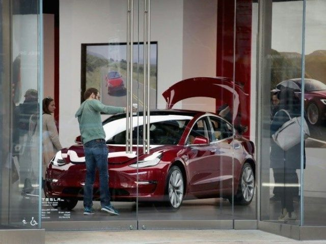 Tesla stock downgraded amid Model 3 order cancellations