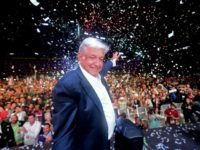Mexico's president-elect Andres Manuel Lopez Obrador (C) cheers his supporters at the Zocalo Square in Mexico City after winning general elections