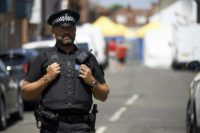 A police officer stands guard at a cordon near Rollestone Street in Salisbury, southern England