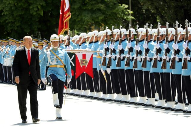 Erdogan takes on new powers, names son-in-law finance chief
