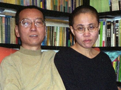 Liu Xiaobo and his wife Liu Xia shown in October 22, 2002. Liu Xia was put under house arrest after her husband won the Nobel Peace Prize and their supporters often say she is guilty of nothing but the 'crime' of being Liu Xiaobo's wife
