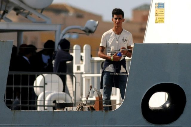 "The 67 migrants -- including women and children -- stuck on the ""Diciotti"" at the port in Trapani are at the centre of a row after a handful reportedly revolted after their rescue amid fears that they would be returned to Libya"