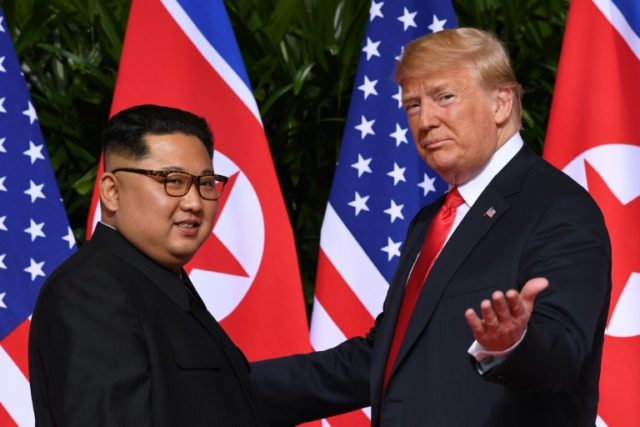US President Donald Trump and North Korea's leader Kim Jong Un, at the start of their historic summit in in Singapore on June 12, 2018