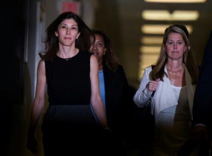 Former FBI lawyer Lisa Page (left) heads into a closed-door meeting with US lawmakers to testify about anti-Trump texts that she exchanged with FBI agent Peter Strzok