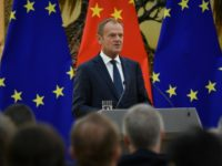 "Tusk warned in Beijing that the trade tensions could spiral into a ""hot conflict"""