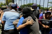 Some 200 students spent 20 hours cowering in a church besieged by pro-government forces
