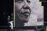 """Changing times: Obama warned of the """"politics of fear and resentment"""" in the annual Nelson Mandela lecture in Johannesburg"""