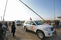 A file picture shows a convoy transporting civilians from the besieged Shiite areas of Fuaa and Kafraya in rebel-held northwestern Syria arriving at the Al-Eis crossing on May 1, 2018