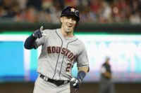 Alex Bregman of the Houston Astros and the American League celebrates as he rounds the bases after hitting a solo home run in the tenth inning against the National League, during the 89th MLB All-Star Game in Washington, DC, on July 17, 2018