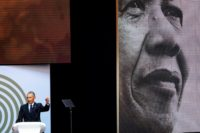 Former US President Barack Obama spoke during the 2018 Nelson Mandela Annual Lecture at the Wanderers cricket stadium in Johannesburg on July 17
