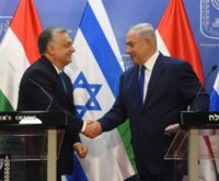 Hungarian Prime Minister Viktor Orban (L) shakes hands with Israeli Prime Minister Benjamin Netanyahu (R) during a visit by the Hungarian premier to Jerusalem on July 19, 2019