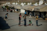 Syrian children play at a refugee camp in the Kilis district of Gaziantep, southeastern Turkey, on October 23, 2016