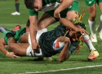 Justin Geduld of South Africa reaches for a try as Foster Horan of Ireland tries to stop him during their men's round of 16 game at the Rugby Sevens World Cup in San Francisco