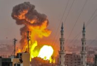 A picture taken on July 20, 2018 shows a fireball exploding in Gaza City during Israeli bombardment