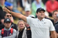 Masters champion Patrick Reed looked to have made the most of just making the weekend play at The British Open by rattling in three birdies in his opening nine holes to move to level par, still six off joint leaders Zach Johnson and Kevin Kisner