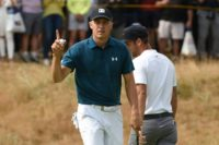 Jordan Spieth reacts after holing his eagle putt on the first on Saturday
