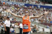 Tom Bosworth celebrates after winning the men's 3000m race walk in a new world record time