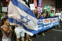 Protesters march against Israel's nation-state law in the city of Tel Aviv on July 14, 2018