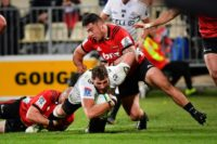 Sharks' captain Ruan Botha (C) is tackled by Crusaders Owen Franks (L) and David Havili during the Super Rugby quarter-final in Christchurch