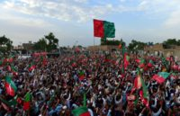 Supporters of cricketer-turned-politician and head of Pakistan's Tehreek-i-Insaf (PTI) party, Imran Khan, attend Khan's election campaign rally in Charsadda district of Khyber-Pakhtunkhwa province, northwest Pakistan, on July 5, 2018