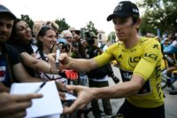Geraint Thomas signed autographs before the start of Sunday's stage, but some fans have booed the Sky rider in his yellow jersey.