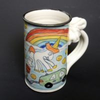 The story began last year after Elon Musk tweeted a picture of the colorful mug, which depicts a crudely drawn unicorn against a rainbow, with smiley-face emojis in the background