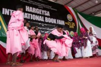 In the pink: Performers celebrate the start of the Hargeisa International Book Fair -- the event has restored life to a literary scene that once was one of the most vibrant in Africa