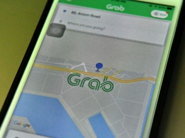 Ride-hailing firm Grab hits back in Uber takeover row