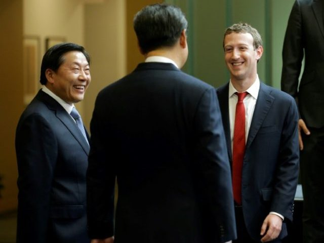 Chinese President Xi Jinping, centre, talks with Facebook chief executive Mark Zuckerberg, right, as Lu Wei, left, China's Internet czar, looks on at Microsoft's main campus in 2015