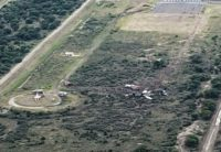 An image taken using a drone and obtained by AFP shows the aircraft immobilized in a field at the end of the runway