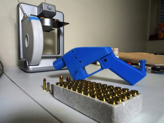 A Liberator pistol appears next to the 3D printer on which its components were made Defense Distributed