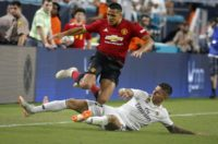Manchester United's Alexis Sanchez (top) fights for the ball with Real Madrid's Javier Sanchez during their International Champions Cup friendly match, at Hard Rock Stadium in Miami, Florida, on July 31, 2018