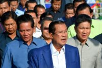 Cambodia's strongman leader Hun Sen (C) has hailed the election as 'free, fair and just'