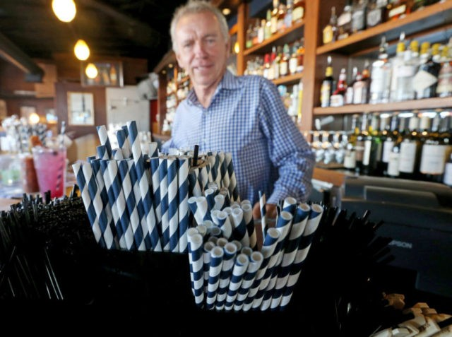 In this June 19, 2018 photo, paper straws sit at Duke Moscrip, owner of Duke's Restaurants, bar at his restaurant in Seattle. Businesses that sell food or drinks won't be allowed to offer the plastic items under a rule that went into effect Sunday, July 1. (Greg Gilbert/The Seattle Times …