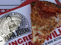 FILE- This Dec. 21, 2017, file photo shows a slice of cheese pizza at the Papa John's pizza shop in Quincy, Mass. Papa John's plans to pull Schnatter's image from marketing materials after reports he used a racial slur. Schnatter apologized Wednesday, July 11, and said he would resign as …