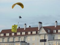 "In this Friday, July 13, 2018 photo, a Greenpeace protester flying a microlight passes over US President's Donald Trump's resort in Turnberry, South Ayrshire, Scotland with a banner reading ""Trump: Well Below Par"", shortly after the US President arrived at the hotel. Scottish police said the protester breached a no-fly …"