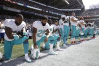 APNewsBreak: Dolphins anthem punishment includes suspensions