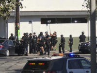 Shooting suspect in standoff at LA market; 1 woman killed