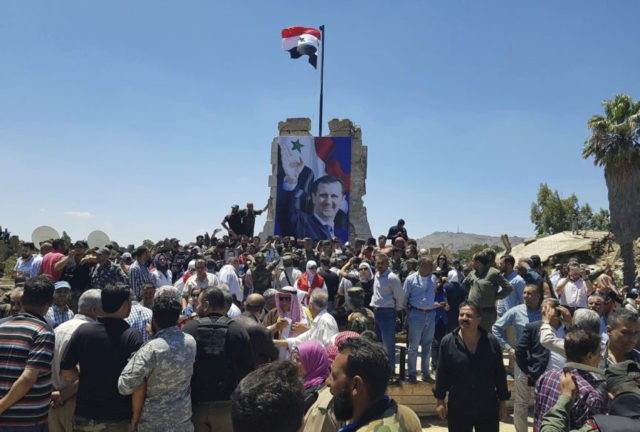 Syria revels in recapture of town near Israel-occupied Golan